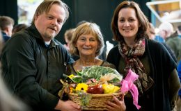 Cathleen Connole recieving a raffel prize with Martin Waldron and Tina O'Dwyer of the Burren Ecotourism Network